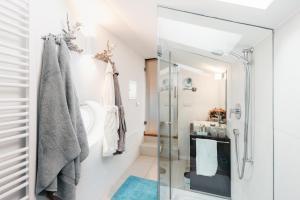 Ein Badezimmer in der Unterkunft Thaler Rooms