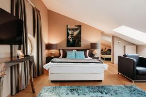 Ein Bett oder Betten in einem Zimmer der Unterkunft Thaler Rooms