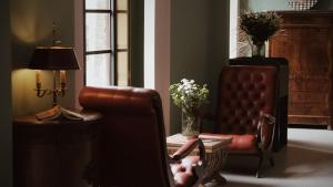A seating area at Moon and Chalice Boutique Hotel