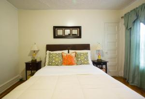 A bed or beds in a room at A and FayeBed and Breakfast, Inc,