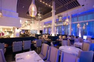 A restaurant or other place to eat at Hotel X Toronto by Library Hotel Collection