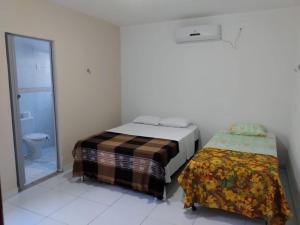 A bed or beds in a room at Casa de Praia