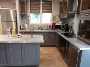A kitchen or kitchenette at Villa sainte valière