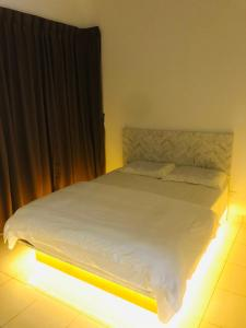 A bed or beds in a room at 75 Suite