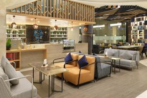 The lounge or bar area at Novotel Jakarta Cikini