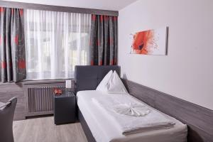 Ein Bett oder Betten in einem Zimmer der Unterkunft Hotel Ganslhof