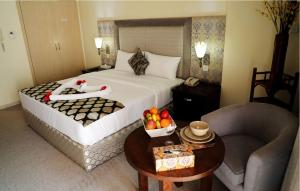 A bed or beds in a room at Parkside Hotel Apartment
