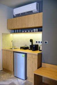 A kitchen or kitchenette at Eva Apartments