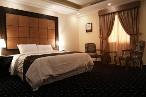 A bed or beds in a room at Wakan Al Salama