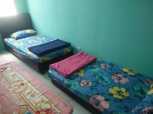Katil atau katil-katil dalam bilik di Aliya Muslims Homestay CH