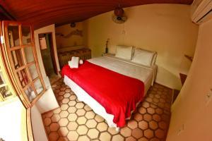 Cama ou camas em um quarto em Pouso da Trilha Hospedagem
