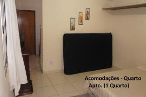 A television and/or entertainment center at Apto Praia de Setiba