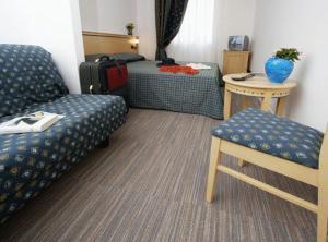 Cama o camas de una habitación en Hotel Mary