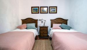 A bed or beds in a room at Casas rurales de Guayadeque