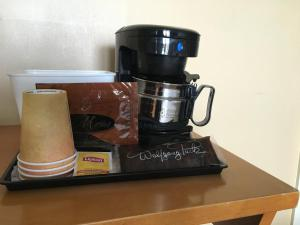 Coffee and tea-making facilities at La Luna Inn, a C-Two Hotel