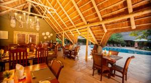 A restaurant or other place to eat at Bayete Guest Lodge