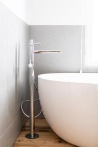 A bathroom at Craveiral Farmhouse by Belong