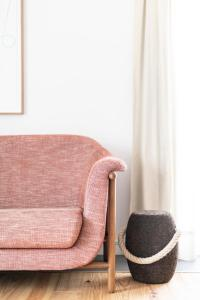A seating area at Craveiral Farmhouse by Belong