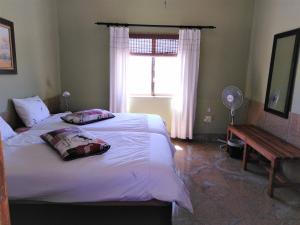 A bed or beds in a room at Ukuib Guest Farm and Camping