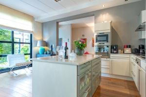 A kitchen or kitchenette at Europea Rooftop Duplex Residence - Brussels Uccle