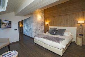 Ein Bett oder Betten in einem Zimmer der Unterkunft Palace Hotel Wellness & Beauty