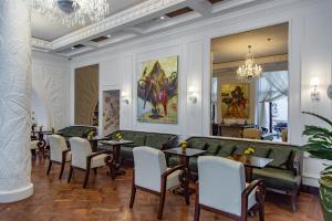 Um restaurante ou outro lugar para comer em Boutique 19 Hotel