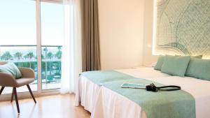 Cama o camas de una habitación en Golden Taurus Aquapark Resort