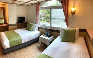 A bed or beds in a room at Cing Shan Hotel