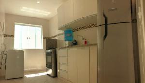 A kitchen or kitchenette at Praia Grande, Angra dos Reis