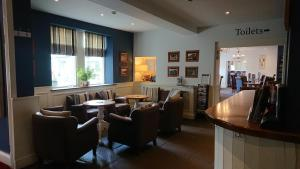 A restaurant or other place to eat at The Craven Heifer Inn