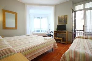 Cama o camas de una habitación en Pensión San Telmo / San Juan
