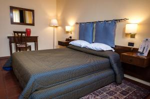 A bed or beds in a room at Corsaro Etna Hotel&SPA