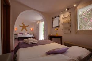 A bed or beds in a room at L'Oasi Villaggio Albergo