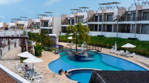 Uma vista da piscina em Condomínio Brisas do Amor ou nos arredores
