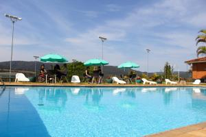 The swimming pool at or near Hotel Brisa do Japi
