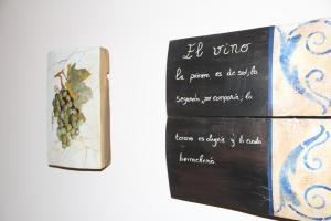A certificate, award, sign, or other document on display at Casa Rural La Torre De Babel