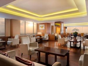 A restaurant or other place to eat at JW Marriott Hotel Medan