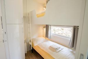 Ein Bett oder Betten in einem Zimmer der Unterkunft Camping Kaul