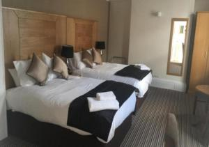 A bed or beds in a room at The Castle Hotel Neath