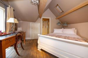 A bed or beds in a room at d'Parys