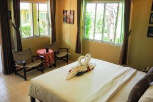 A bed or beds in a room at Lanta Castaway Beach Resort