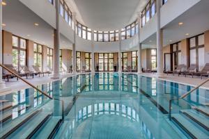 The swimming pool at or near Grand Hotel des Bains Kempinski