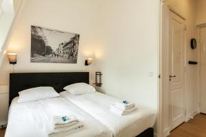 A bed or beds in a room at Stayci Serviced Apartments Central Station