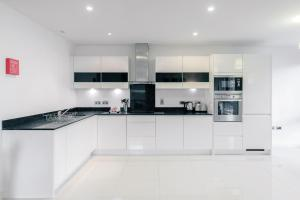 A kitchen or kitchenette at Roomspace Serviced Apartments - The Residence