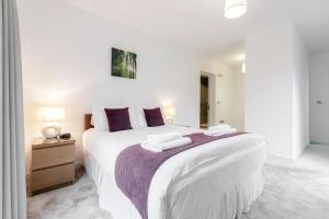 A bed or beds in a room at Roomspace Serviced Apartments - The Residence