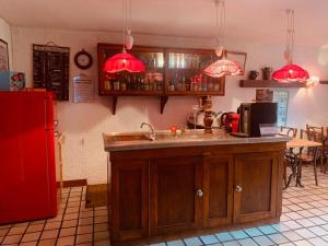 A kitchen or kitchenette at Le Castel Blanc