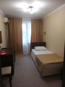 Кровать или кровати в номере Санаторий «Русь»