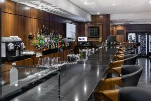 The lounge or bar area at Grand Hotel Rayon