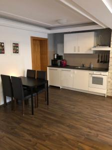 Küche/Küchenzeile in der Unterkunft Apartment Roxheim