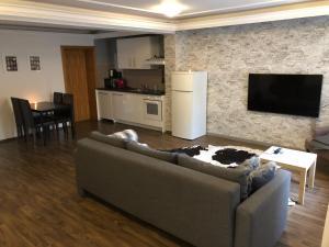 Ein Sitzbereich in der Unterkunft Apartment Roxheim